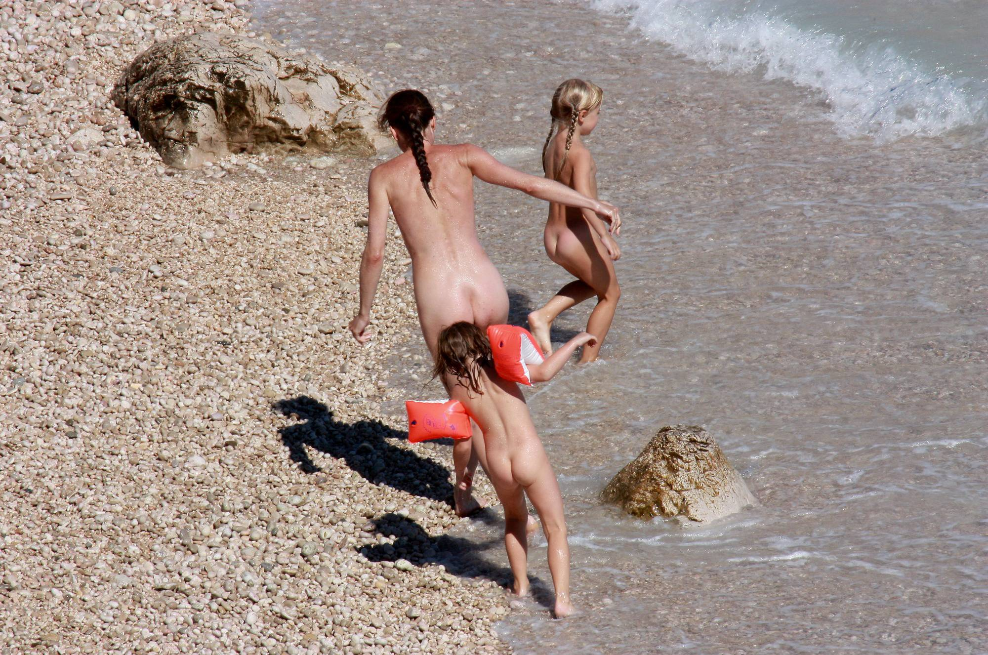 Nudist Pictures Getting Out of the Waters - 1