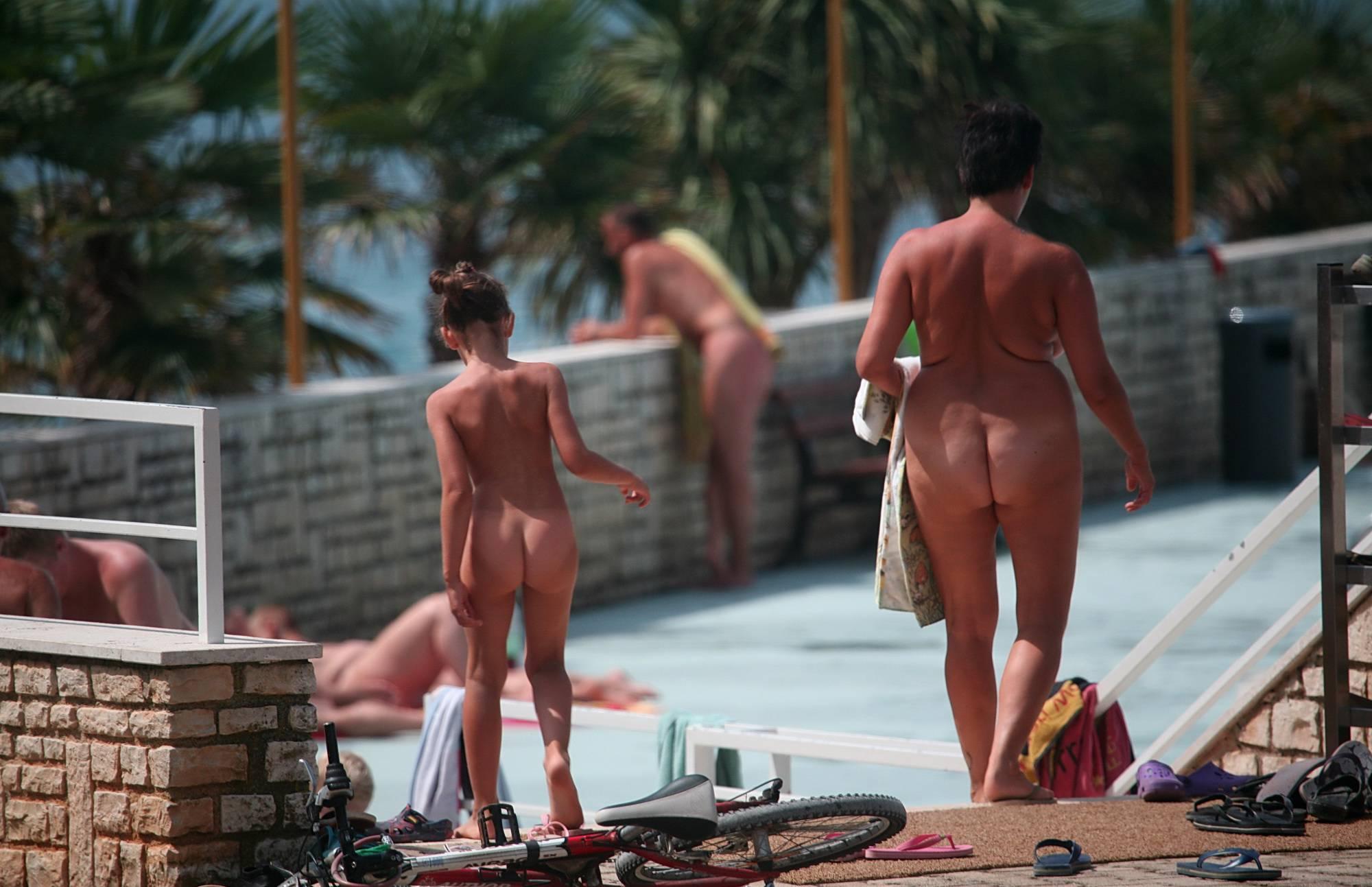 Nudist Pics Good Friends by the Pool - 1