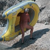 Lone Nudist in Yellow Boat
