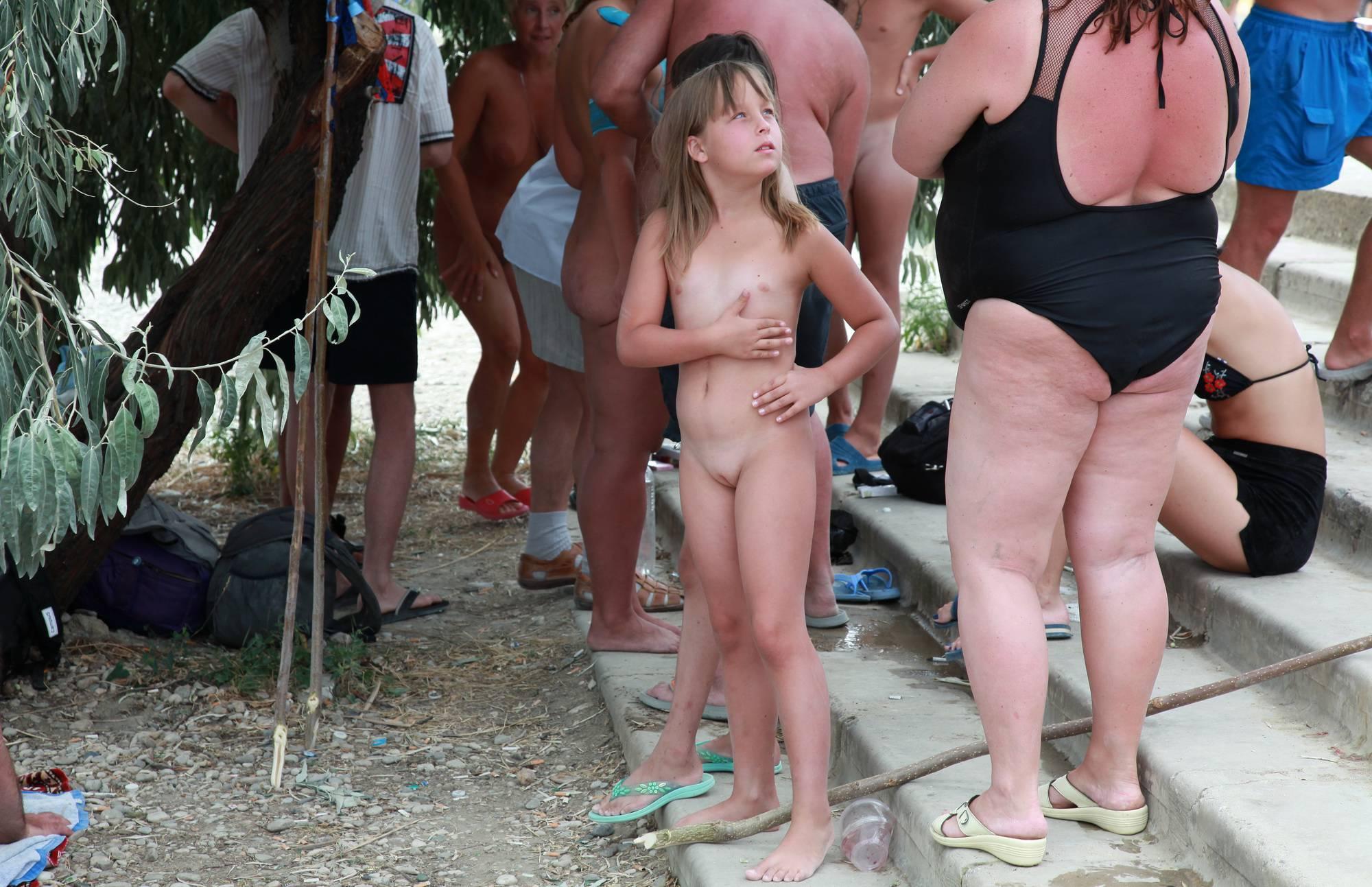 Nudist Pictures Neptune Two Nudists Wait - 2