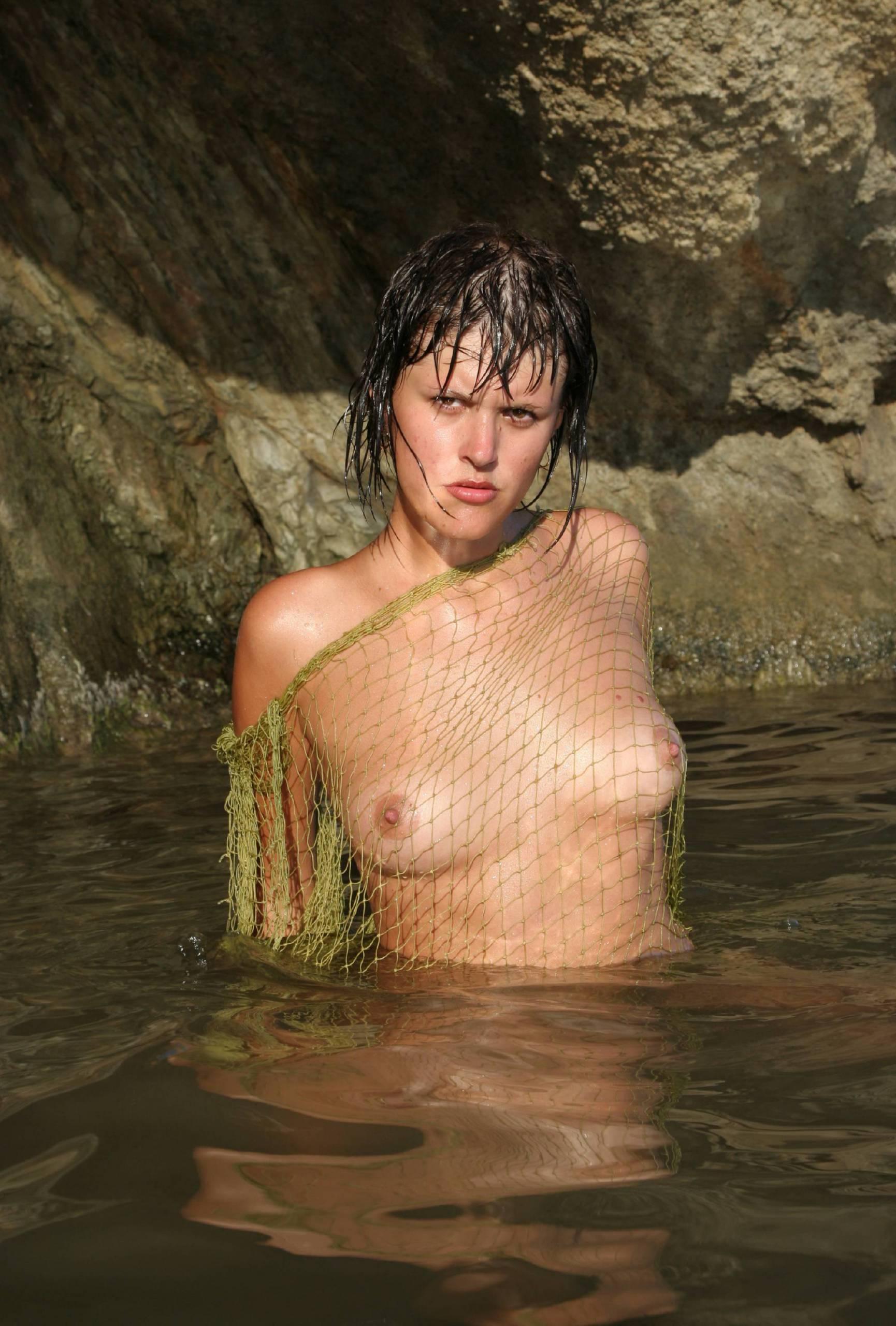 Nudist Photos Against Rocky Backdrops - 1