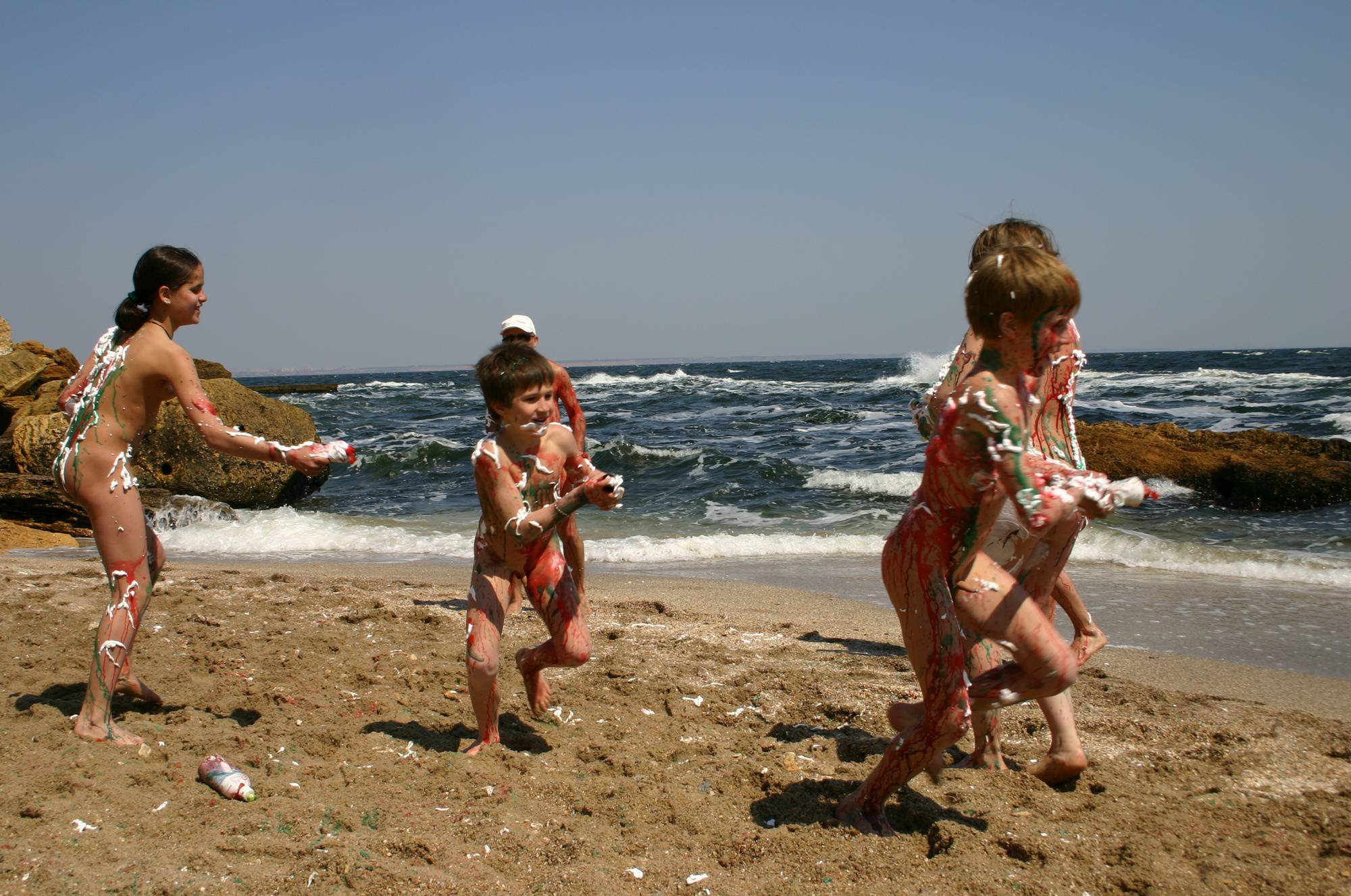 Nudist Gallery Beach Paint Fight Actions - 1