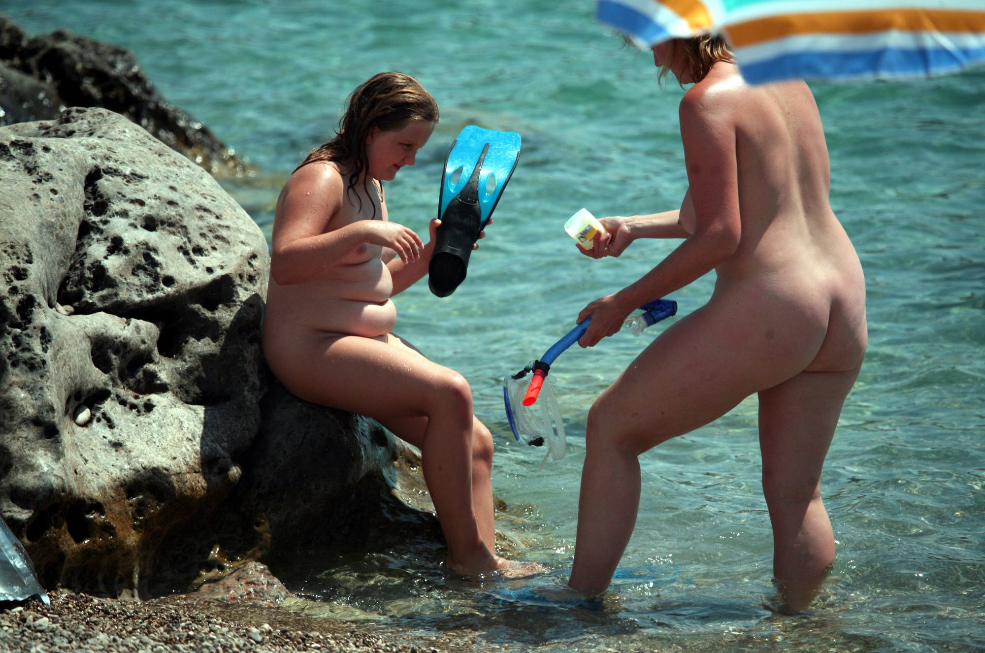 Nudist Pics Putting on the Scuba Gear - 1