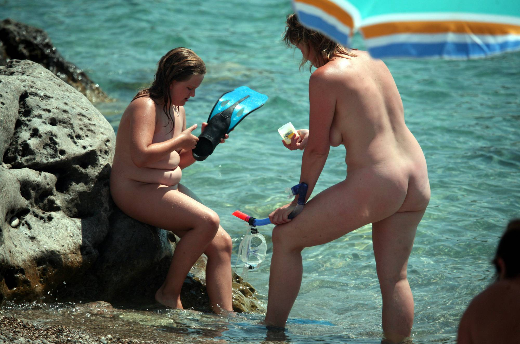 Nudist Pictures Putting on the Scuba Gear - 2